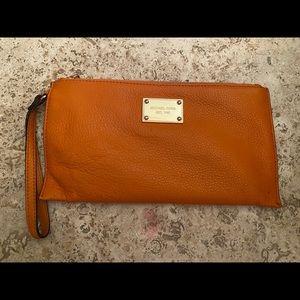 MICHAEL KOHRS orange wristlet(small pen mark)